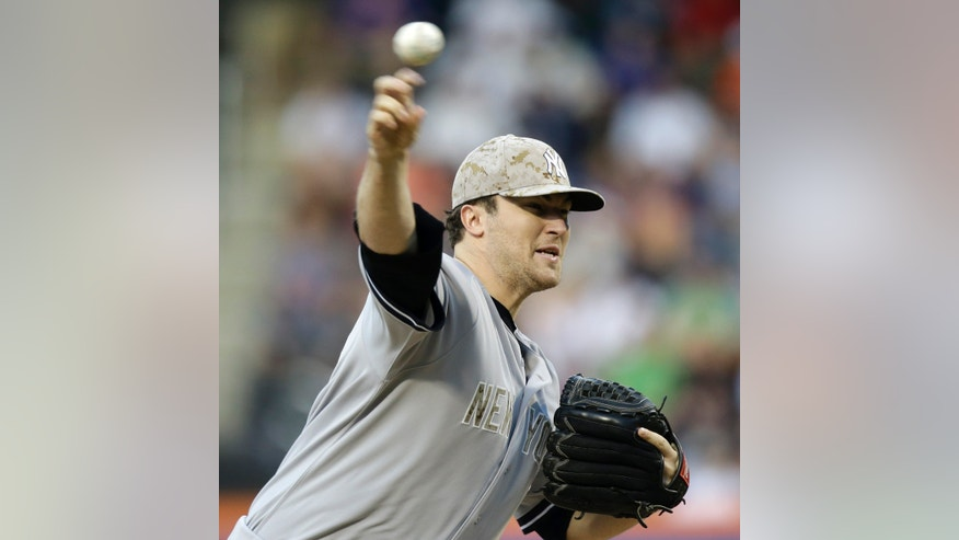 New York Yankees starting pitcher Phil Hughes delivers in the first inning of an interleague baseball game at Citi Field in New York, Monday, May 27, 2013. (AP Photo/Kathy Willens)