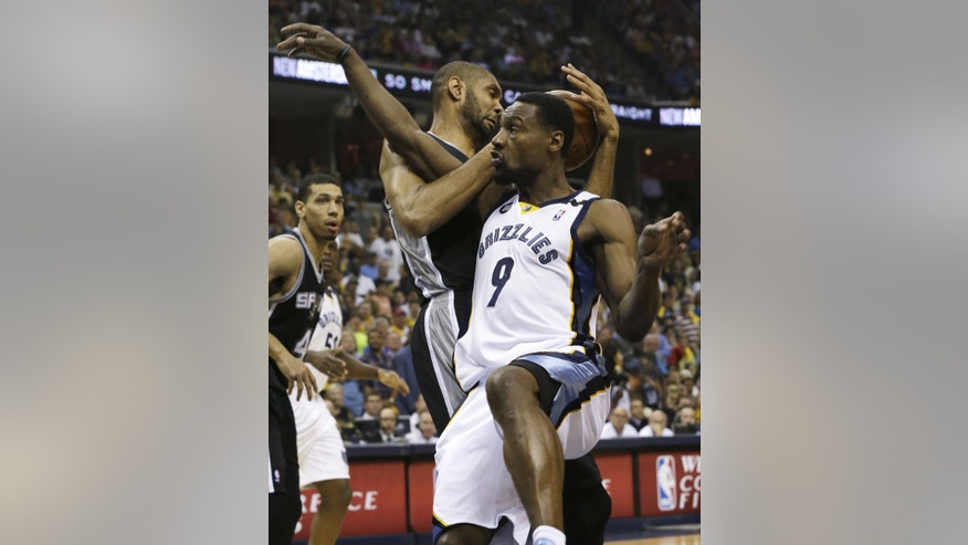 Memphis Grizzlies guard Tony Allen (9) is fouled by San Antonio Spurs  forward Tim Duncan (21) of U.S. Virgin Islands, during the first half in Game 4 of the Western Conference finals NBA basketball playoff series in Memphis, Tenn., Monday, May 27, 2013. (AP Photo/Danny Johnston)