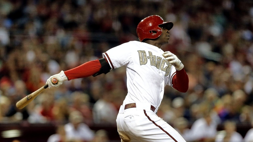Arizona Diamondbacks' Didi Gregorius follows through on a two run home run against the Texas Rangers during the eighth inning of an interleague baseball game, Monday, May 27, 2013, in Phoenix. (AP Photo/Matt York)