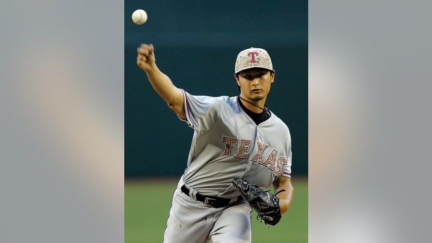 Texas Rangers pitcher Yu Darvish, of Japan, delivers a pitch against the Arizona Diamondbacks during the first inning of an interleague baseball game, Monday, May 27, 2013, in Phoenix. (AP Photo/Matt York)