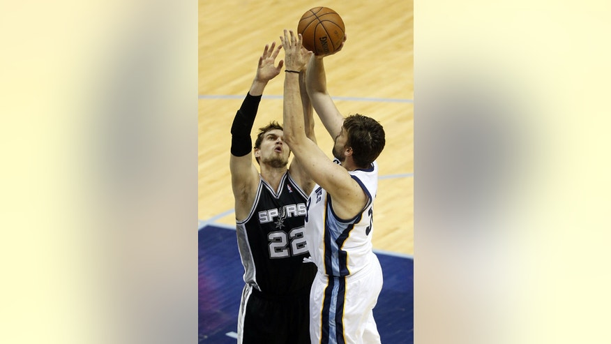 Memphis Grizzlies center Marc Gasol (33) aims for the basket as San Antonio Spurs center Tiago Splitter (22) defends during the first half in Game 4 of the Western Conference finals NBA basketball playoff series, Monday, May 27, 2013, in Memphis, Tenn. (AP Photo/Rogelio V. Solis)