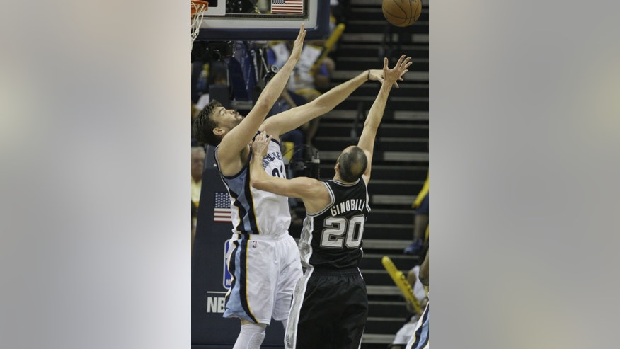 Memphis Grizzlies center Marc Gasol (33) blocks a shot by San Antonio Spurs  guard Manu Ginobili (20) during the first half in Game 4 of the Western Conference finals NBA basketball playoff series in Memphis, Tenn., Monday, May 27, 2013. (AP Photo/Danny Johnston)