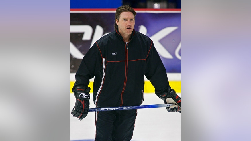 FILE- Inthis May 27, 2006, file photo, Quebec Remparts coach Patrick Roy puts his squad through hockey practice in Moncton, New Brunswick. The Colorado Avalanche announced Thursday, May 23, 2013, that they hired Patrick Roy as their new head coach.  (AP Photo/The Canadian Press, Andrew Vaughan, File)