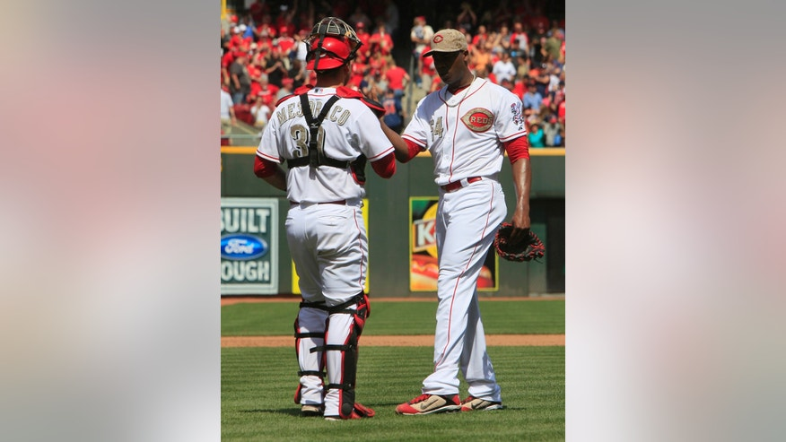 Cincinnati Reds relief pitcher Aroldis Chapman, right, is congratulated by catcher Devin Mesoraco, left, after beating the Cleveland Indians 4-2 during a baseball game, Monday, May 27, 2013, in Cincinnati. (AP Photo/David Kohl)