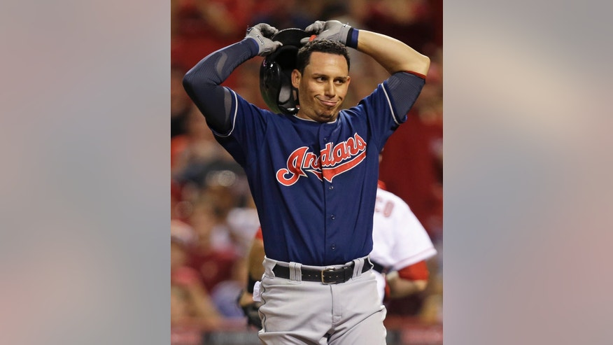 Cleveland Indians' Asdrubal Cabrera tosses his helmet after striking out in the seventh inning of a baseball game against the Cincinnati Reds, Tuesday, May 28, 2013, in Cincinnati. (AP Photo/Al Behrman)