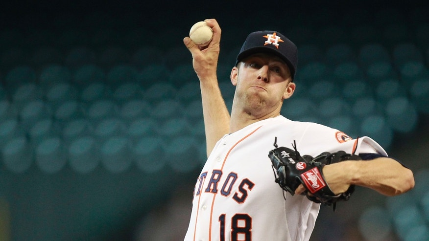 Houston Astros pitcher Jordan Lyles throws in the first inning of a baseball game against the Colorado Rockies, Tuesday, May 28, 2013, in Houston. (AP Photo/Patric Schneider)
