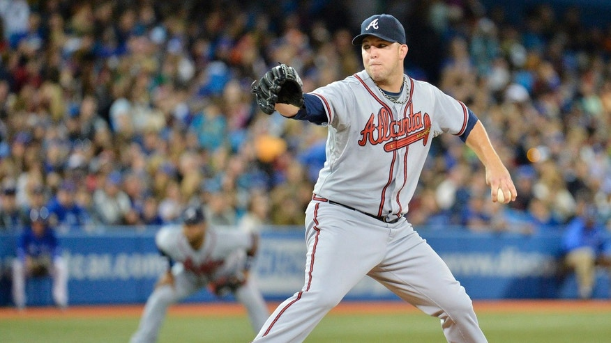 Atlanta Braves starting pitcher Paul Maholm works against the Toronto Blue Jays during first inning interleague baseball action in Toronto on Tuesday, May 28, 2013. (AP Photo/The Canadian Press, Nathan Denette)