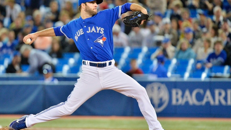 Toronto Blue Jays starting pitcher Brandon Morrow works against the Atlanta Braves during first inning interleague baseball action in Toronto on Tuesday, May 28, 2013. (AP Photo/The Canadian Press, Nathan Denette)