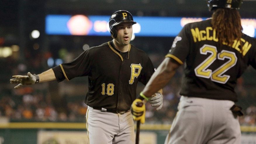 Pittsburgh Pirates' Neil Walker (18) is congratulated by teammate Andrew McCutchen after hitting a solo home run during the 11th inning of an interleague baseball game against the Detroit Tigers in Detroit, Tuesday, May 28, 2013. (AP Photo/Carlos Osorio)