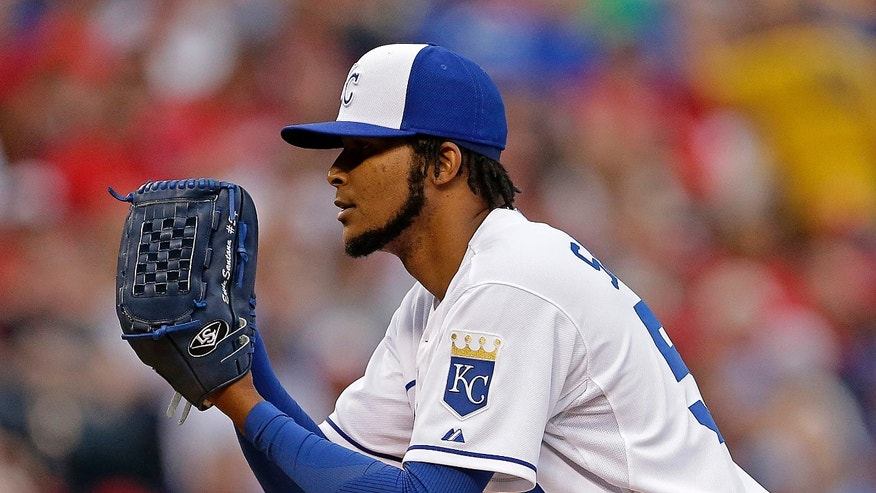 Kansas City Royals starting pitcher Ervin Santana throws during the first inning of a baseball game against the St. Louis Cardinals Tuesday, May 28, 2013, in Kansas City, Mo. (AP Photo/Charlie Riedel)