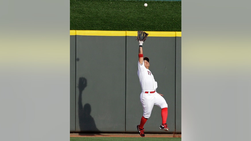 Cincinnati Reds center fielder Shin-Soo Choo catches a fly ball hit by Cleveland Indians' Jason Kipnis in the first inning of a baseball game Tuesday, May 28, 2013, in Cincinnati. (AP Photo/Al Behrman)