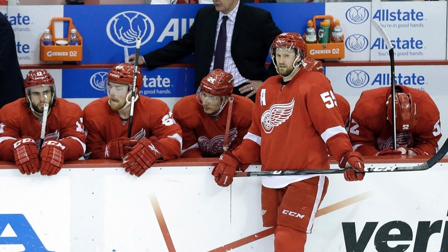 Detroit Red Wings players watch from the bench against the Chicago Blackhawks during the third period in Game 6 of the Western Conference semifinals in the NHL hockey Stanley Cup playoffs in Detroit, Monday, May 27, 2013. Chicago won 4-3. (AP Photo/Paul Sancya)