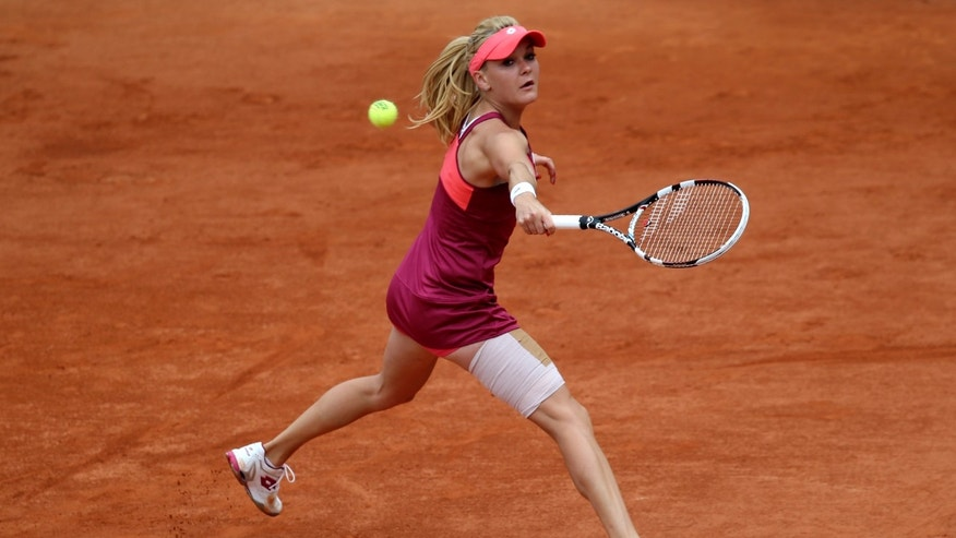 Poland's Agnieszka Radwanska returns the ball to Mallory Burdette, of the U.S, during their second round match of the French Open tennis tournament at the Roland Garros stadium Wednesday, May 29, 2013 in Paris. (AP Photo/Michel Euler)