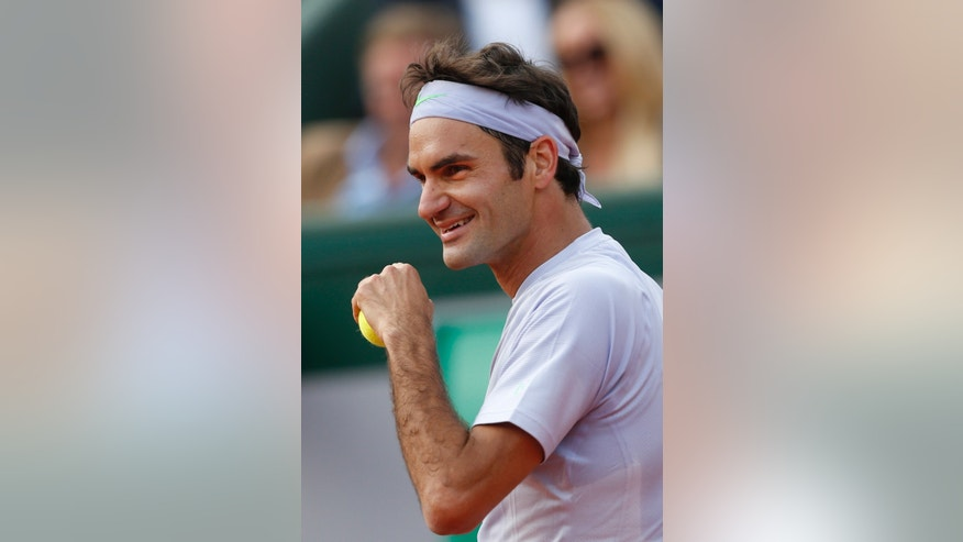 Switzerland's Roger Federer smiles as he plays against India's Somdev Devvarman in their second round match of the French Open tennis tournament, at Roland Garros stadium in Paris, Wednesday, May 29, 2013. Federer won in three sets 6-2, 6-1, 6-1. (AP Photo/Petr David Josek)
