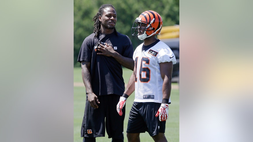 Cincinnati Bengals cornerback Adam Jones talks with wide receiver Andrew Hawkins (16) during NFL football practice, Wednesday, May 29, 2013, in Cincinnati. (AP Photo/Al Behrman)