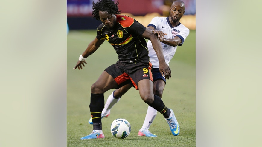 Belgium forward Romelu Lukaku (9) shields the ball from U.S. defender DaMarcus Beasley during the first half of an international friendly soccer game Wednesday, May 29, 2013, in Cleveland. (AP Photo/Tony Dejak)