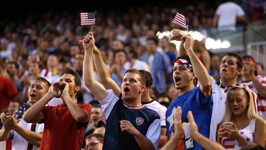 U.S. fans cheer during an international friendly soccer game between the United States and Belgium on Wednesday, May 29, 2013, in Cleveland. (AP Photo/Tony Dejak)
