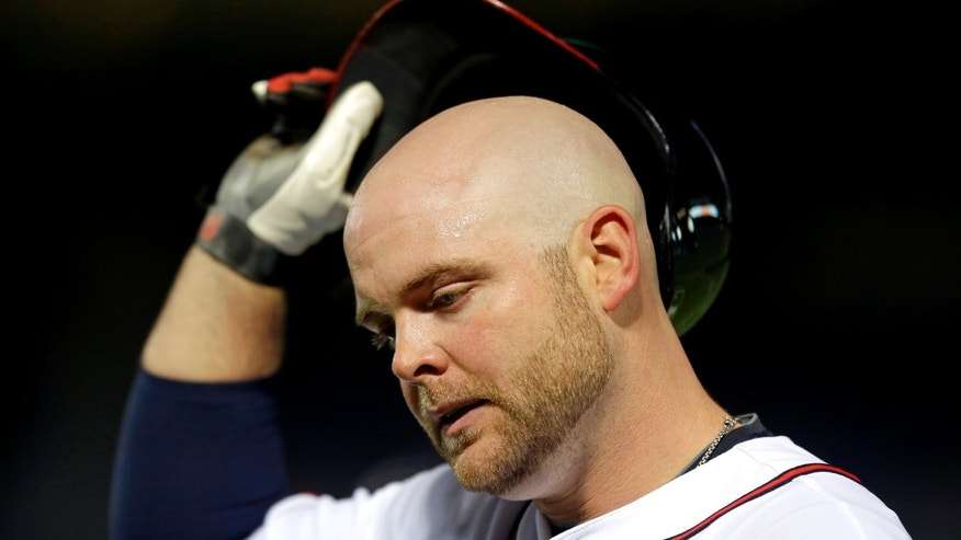 Atlanta Braves' Brian McCann walks back to the dugout after grounding out during the sixth inning of a baseball game against the Toronto Blue Jays, Wednesday, May 29, 2013, in Atlanta. (AP Photo/David Goldman)