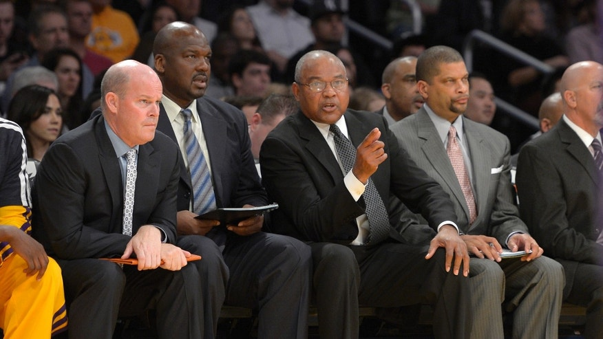 FILE - In this Nov. 9, 2012 file photo, Los Angeles Lakers interim head coach Bernie Bickerstaff, second from right, looks on along with assistant coaches Steve Clifford, left, Chuck Person, second from left, and Eddie Jordan, right, during the first half of their NBA basketball game against the Golden State Warriors in Los Angeles. Michael Jordan felt he needed a head coach with a little more NBA experience this time around to improve his struggling Charlotte Bobcats. The former NBA superstar and current owner believes he's found one in Steve Clifford. (AP Photo/Mark J. Terrill, File)