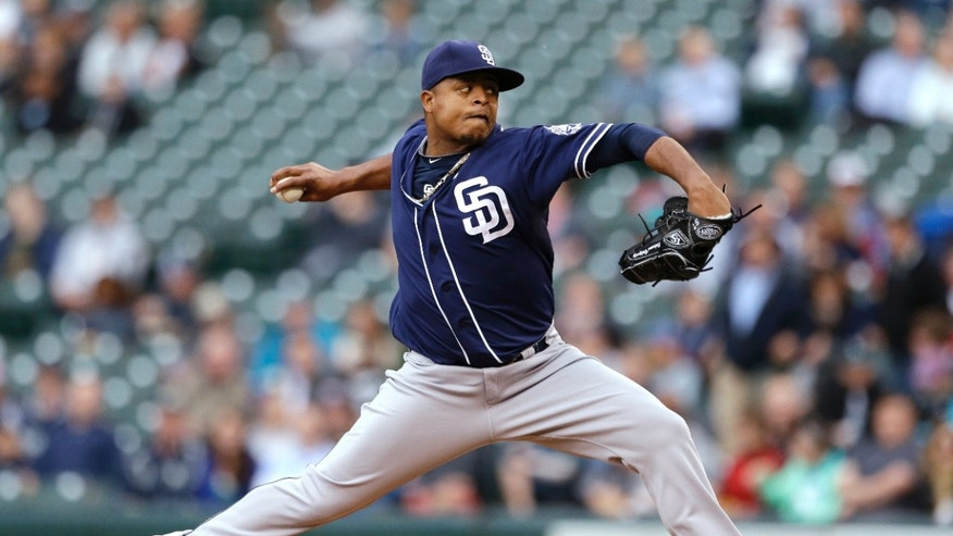 San Diego Padres starting pitcher Edinson Volquez throws to a Seattle Mariners batter in the first inning of a baseball game Tuesday, May 28, 2013, in Seattle. (AP Photo/Elaine Thompson)