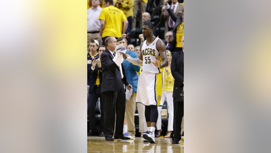 Indiana Pacers' Roy Hibbert reacts after the Pacers defeated the Miami Heat 99-92 in Game 4 of the NBA basketball Eastern Conference finals, Tuesday, May 28, 2013, in Indianapolis. (AP Photo/Michael Conroy)