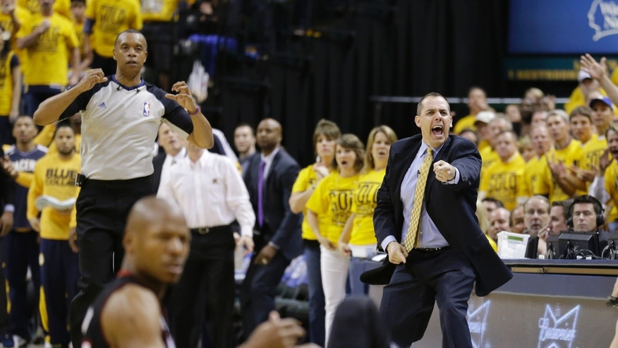 Indiana Pacers coach Frank Vogel reacts after a foul was called against the Pacers during the second half against the Miami Heat in  Game 4 of the NBA basketball Eastern Conference finals, Tuesday, May 28, 2013, in Indianapolis. The Pacers won 99-92. (AP Photo/Michael Conroy)