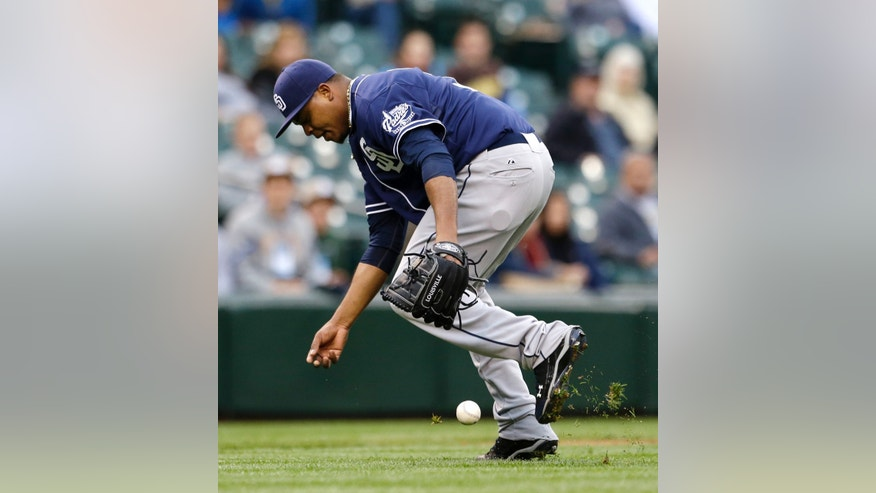 San Diego Padres starting pitcher Edinson Volquez can't make the grab on a grounder from Seattle Mariners' Kendrys Morales in the second inning of a baseball game Tuesday, May 28, 2013, in Seattle. Morales singled on the play. (AP Photo/Elaine Thompson)