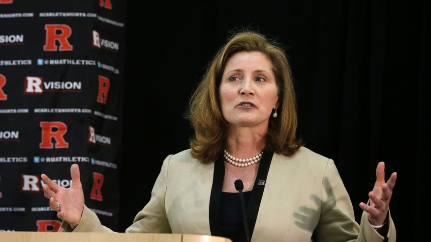 FILE - In this Wednesday, May 15, 2013 file photo, Julie Hermann speaks during a news conference where she was introduced as the new athletic director at Rutgers University, in Piscataway, N.J. Hermann, hired to clean up Rutgers' scandal-scarred athletic program, quit as Tennessee's women's volleyball coach 16 years ago after her players submitted a letter complaining she ruled through humiliation, fear and emotional abuse, The Star-Ledger reported Saturday, May 25, 2013, on its website. (AP Photo/Mel Evans, File)