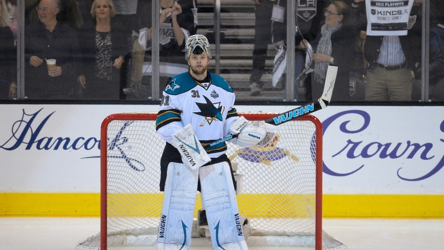 San Jose Sharks goalie Antti Niemi, of Finland, reacts to Los Angeles Kings right wing Justin Williams's goal during the second period of Game 7 of the Western Conference semifinals in the NHL hockey Stanley Cup playoffs, Tuesday, May 28, 2013, in Los Angeles. The Kings advanced to the Western Conference finals with a 2-1 victory over San Jose. (AP Photo/Mark J. Terrill)