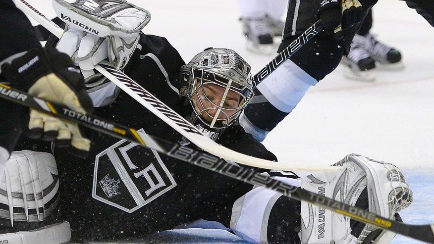 Los Angeles Kings goalie Jonathan Quick makes a save against the San Jose Sharks during the third period in Game 7 of the Western Conference semifinals in the NHL hockey Stanley Cup playoffs, Tuesday, May 28, 2013, in Los Angeles.  (AP Photo/Mark J. Terrill)