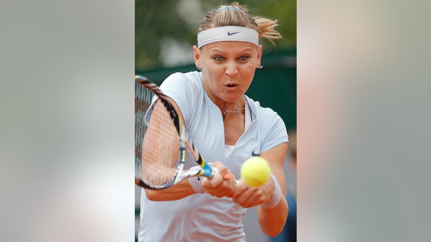 Lucie Safarova of the Czech Republic returns against Jamie Hampton of the U.S. in their first round match of the French Open tennis tournament, at Roland Garros stadium in Paris, Wednesday, May 29, 2013. (AP Photo/Christophe Ena)