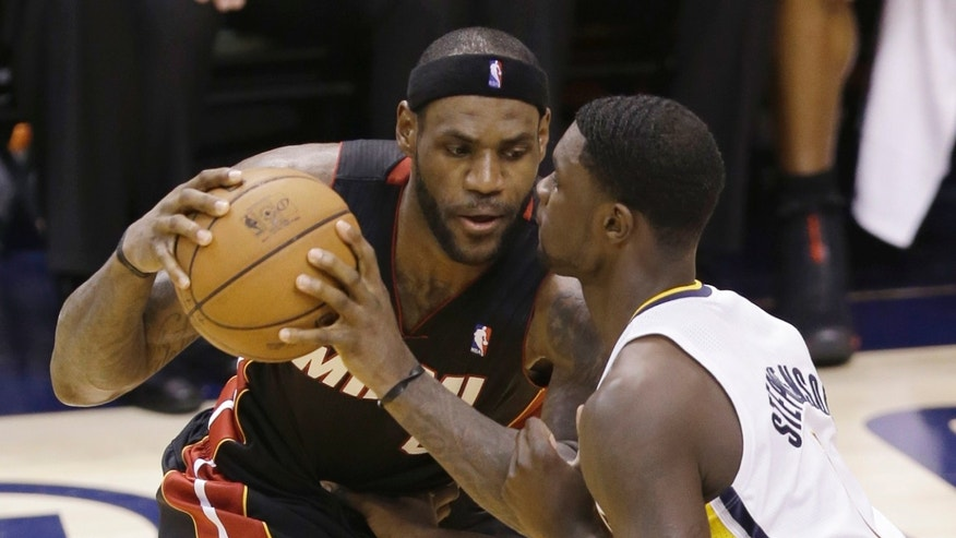Miami Heat's LeBron James, left, gets close defense from Indiana Pacers' Lance Stephenson during the first half of Game 4 of the NBA basketball Eastern Conference finals, Tuesday, May 28, 2013, in Indianapolis. (AP Photo/AJ Mast)
