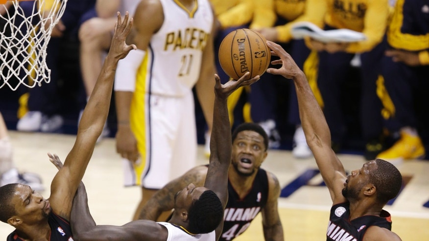 Indiana Pacers' Lance Stephenson (1) has his shot blocked by Miami Heat's Dwyane Wade (3) as Chris Bosh, left, helps defend during the first half of Game 4 of the NBA basketball Eastern Conference finals, Tuesday, May 28, 2013, in Indianapolis. (AP Photo/AJ Mast)