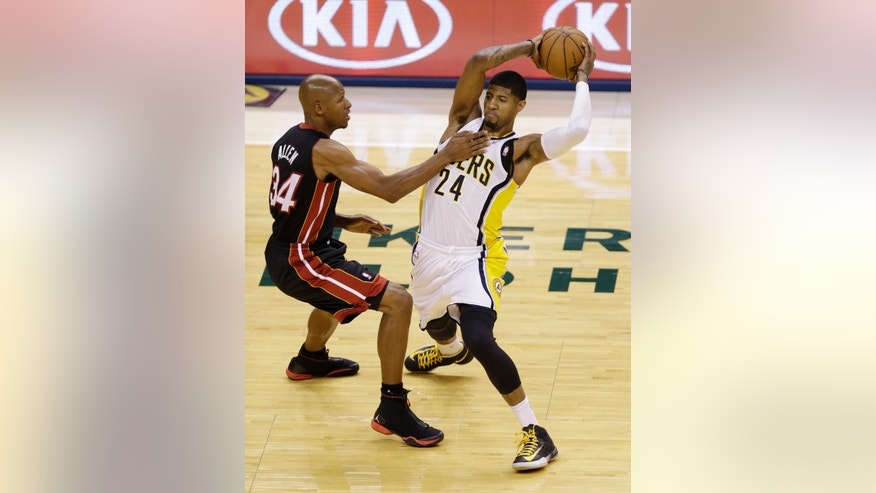 Indiana Pacers' Paul George (24) pulls the ball away from Miami Heat's Ray Allen during the first half of Game 4 of the NBA basketball Eastern Conference finals, Tuesday, May 28, 2013, in Indianapolis. (AP Photo/AJ Mast)