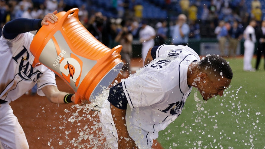 Tampa Bay Rays' Desmond Jennings, right, is doused with ice by Evan Longoria after hiting the game-winning RBI single off Miami Marlins relief pitcher Chad Qualls in the ninth inning of an interleague baseball game Tuesday, May 28, 2013, in St. Petersburg, Fla. The Rays won 7-6. (AP Photo/Chris O'Meara)