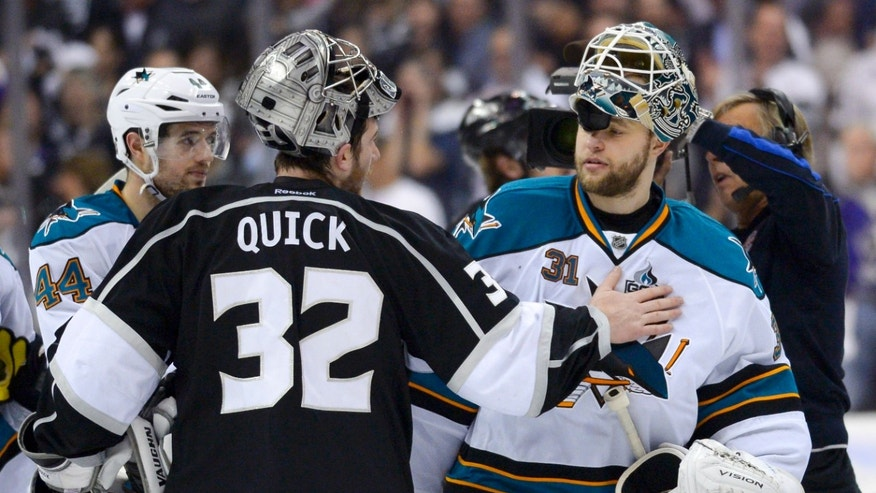 Los Angeles Kings goalie Jonathan Quick, left, greets San Jose Sharks goalie Antti Niemi, of Finland, after the Kings 2-1 win in Game 7 of the Western Conference semifinals in the NHL hockey Stanley Cup playoffs, Tuesday, May 28, 2013, in Los Angeles.  (AP Photo/Mark J. Terrill)