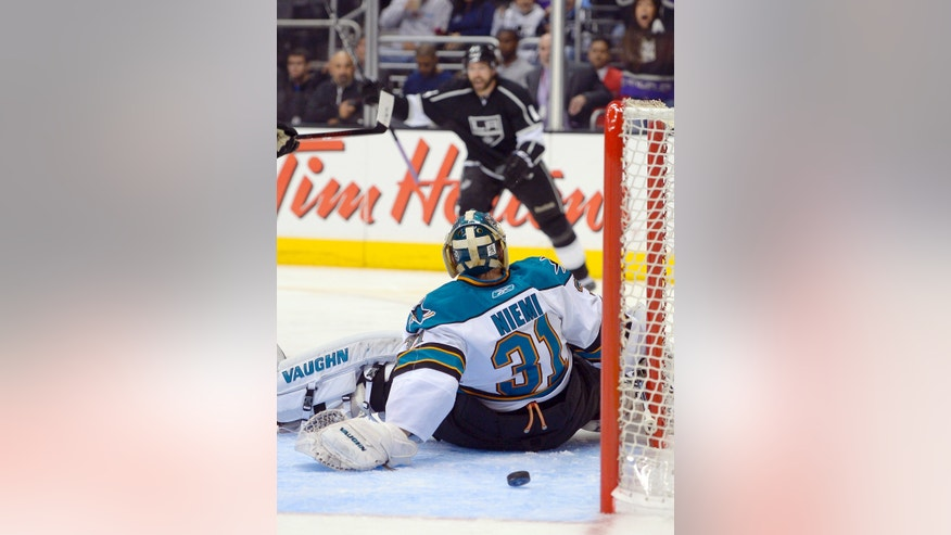 Los Angeles Kings right wing Justin Williams, rear, celebrates after scoring past San Jose Sharks goalie Antti Niemi, of Finland, during the second period in Game 7 of the Western Conference semifinals in the NHL hockey Stanley Cup playoffs, Tuesday, May 28, 2013, in Los Angeles.  (AP Photo/Mark J. Terrill)
