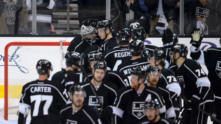 Members of the Los Angeles Kings celebrate their 2-1 victory over the San Jose Sharks in Game 7 of the Western Conference semifinals in the NHL hockey Stanley Cup playoffs, Tuesday, May 28, 2013, in Los Angeles. The Kings advanced to the Western Conference finals. (AP Photo/Mark J. Terrill)