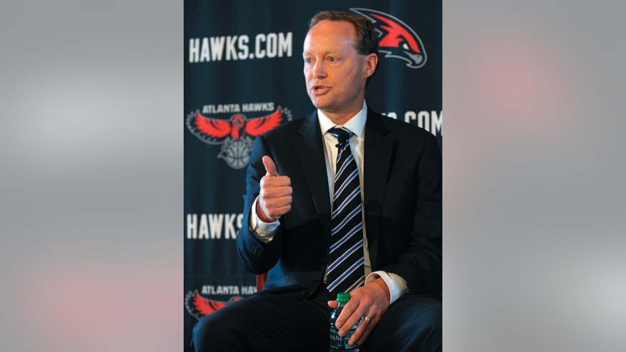 Atlanta Hawks' new NBA head coach Mike Budenholzer gestures as he speaks during a news conference Wednesday, May 29, 2013 in Atlanta. (AP Photo/David Tulis)