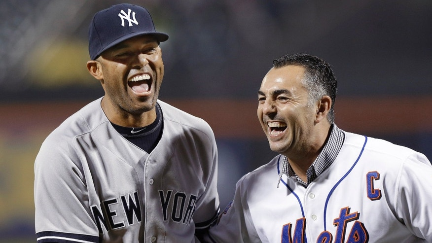 New York Yankees relief pitcher Mariano Rivera, left, laughs with former New York Mets closer John Franco after Franco caught Rivera's ceremonial first pitch before an interleague baseball game at Citi Field in New York, Tuesday, May 28, 2013. (AP Photo/Kathy Willens)