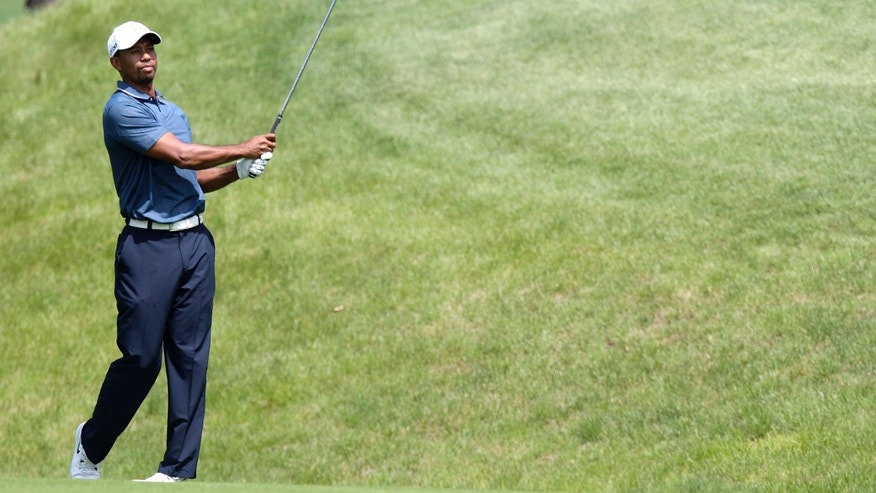 Tiger Woods hits a shot during the pro-am of the Memorial golf tournament Wednesday, May 29, 2013, in Dublin, Ohio. (AP Photo/Jay LaPrete)