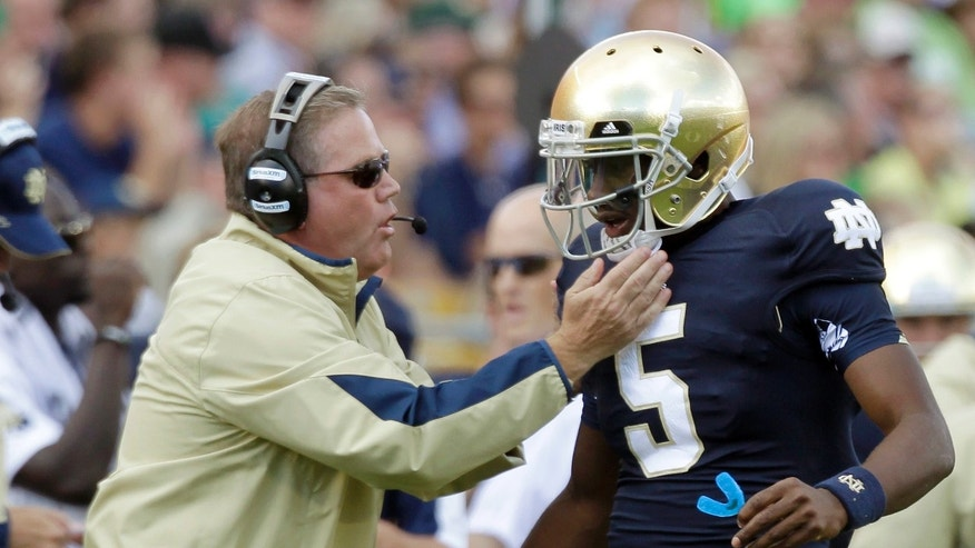 FILE - In this Sept. 8, 2012, file photo, Notre Dame coach Brian Kelly, left, gives a play to quarterback Everett Golson during the first half of an NCAA college football game against Purdue in South Bend, Ind. Golson's high school coach says he believes the quarterback will learn from being suspended by Notre Dame for the fall semester. (AP Photo/Michael Conroy, File)