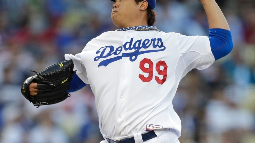 Los Angeles Dodgers starting pitcher Hyun-Jin Ryu, of South Korea, throws against the Los Angeles Angels during the second inning of a baseball game in Los Angeles, Tuesday, May 28, 2013. (AP Photo/Jae C. Hong)