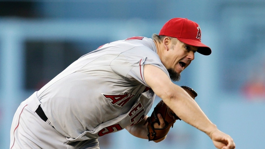Los Angeles Angels starting pitcher Joe Blanton throws against the Los Angeles Dodgers during the first inning of a baseball game in Los Angeles, Tuesday, May 28, 2013. (AP Photo/Jae C. Hong)