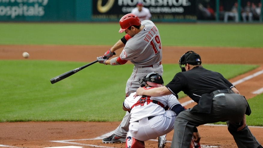 Cincinnati Reds' Joey Votto (19) hits a solo home run off starting Cleveland Indians pitcher Justin Masterson in the first inning of a baseball game on Wednesday, May 29, 2013, in Cleveland. (AP Photo/Mark Duncan)