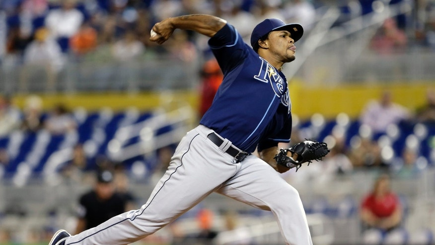 Tampa Bay Rays' Alex Colome pitches against the Miami Marlins in the first inning of an interleague baseball game in Miami, Thursday, May 30, 2013. (AP Photo/Alan Diaz)