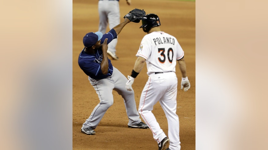 Tampa Bay Rays relief pitcher Fernando Rodney, left, celebrates after Miami Marlins' Placido Polanco (30) grounded out for the final out of an interleague baseball game in Miami, Thursday, May 30, 2013. Tampa Bay won 5-2.  (AP Photo/Alan Diaz)