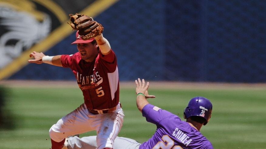 LSU's Chris Chinea (20) is forced out at second on a fielder's choice in the fifth inning by Arkansas' Brett McAfee  in their Southeastern Conference Tournament baseball game at the Hoover Met in Hoover, Ala., Saturday, May 25, 2013. (AP Photo/Dave Martin)
