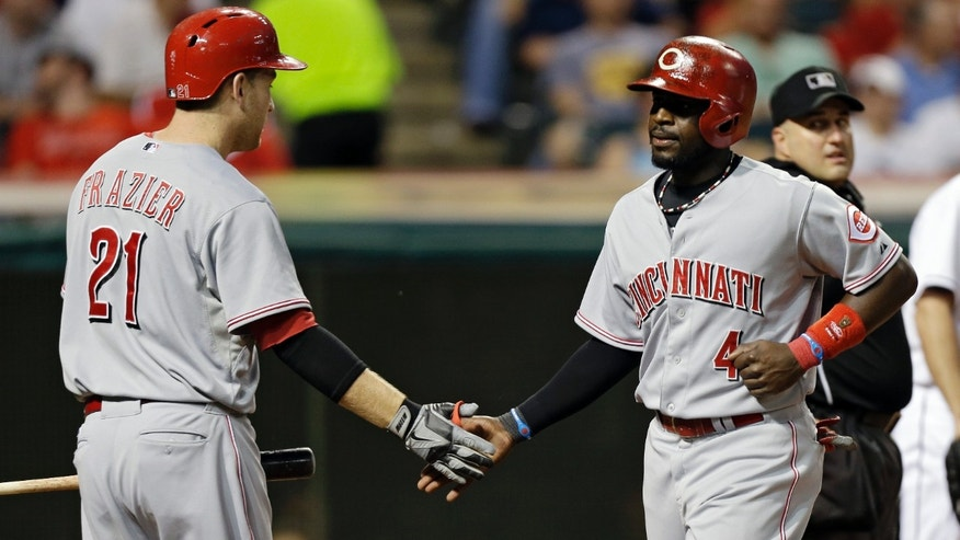 Cincinnati Reds' Brandon Phillips, right, is greeted by Todd Frazier (21) after Phillips scored on a single by Jay Bruce in the sixth inning of a baseball game against the Cleveland Indians, Thursday, May 30, 2013, in Cleveland. (AP Photo/Mark Duncan)