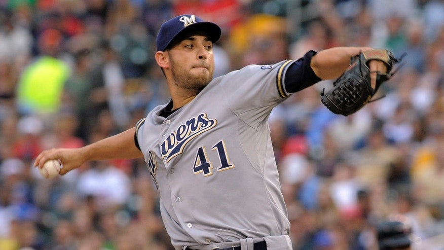Milwaukee Brewers' Marco Estrada pitches against the Minnesota Twins during the first inning of a baseball game on Wednesday, May 29, 2013, in Minneapolis. (AP Photo/Tom Olmscheid)